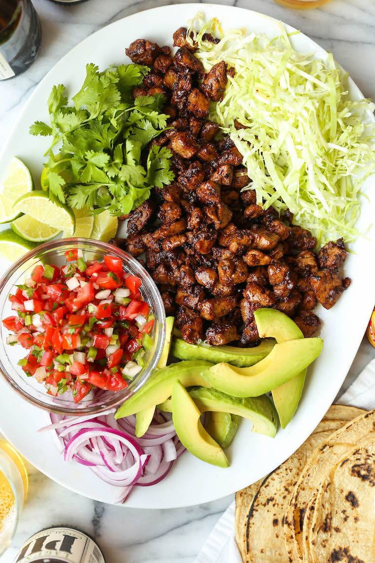 Easy Pork Carnitas - Juicy, tender pork carnitas made in 30 min, start to finish! No fuss, no hassle. Serve as tacos or burrito bowls. So easy, so so good.